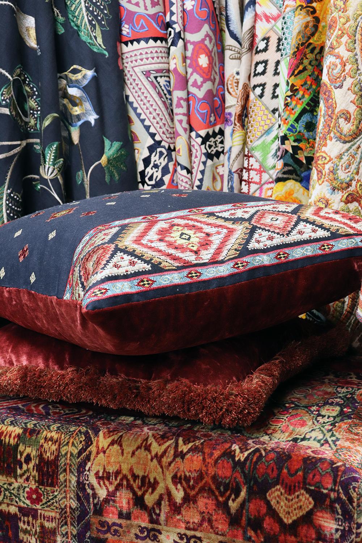 layering fabrics and cushions, curtains